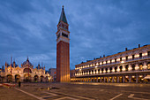 A quiet St. Mark's Square with its Campanile and Basilica during the morning blue hour, Venice, UNESCO World Heritage Site, Veneto, Italy, Europe