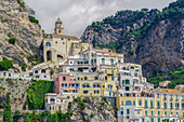 View of low-rise traditional buildings and cliffs along the coastline in Costiera Amalfitana (Amalfi Coast), UNESCO World Heritage Site, Campania, Italy, Europe