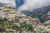 View from sea of low-rise buildings and cliffs along the coastline, Positano, Costiera Amalfitana (Amalfi Coast), UNESCO World Heritage Site, Campania, Italy, Europe