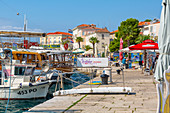 View of boats and buildings in the harbour of the Old Town of Porec and Adriatic Sea, Porec, Istria, Region, Croatia, Europe