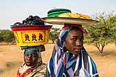 Young girls selling food, Gerewol festival, courtship ritual competition among the Wodaabe Fula people, Niger, West Africa, Africa