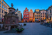 Dusk over the colorful facades of townhouses in the medieval Stortorget Square, Gamla Stan, Stockholm, Sweden, Scandinavia, Europe