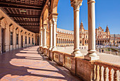 Under the arches of the semicircular Plaza de Espana, Maria Luisa Park, Seville, Andalusia, Spain, Europe