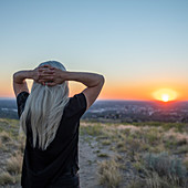 USA, Idaho, Boise, Woman looking at sunset