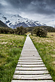 A walkway through a mountain region, near Mount Cook.