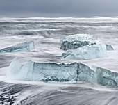 Icebergs on black volcanic beach.  Beach of the north atlantic near the glacial lagoon Joekulsarlon and glacier Breithamerkurjoekull in the Vatnajoekull NP.europe, northern europe, iceland,  February
