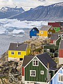 The town Uummannaq in the north of West Greenland, located on an island  in the Uummannaq Fjord System, in background the Nuussuaq (Nugssuaq) Peninsula.  America, North America, Greenland