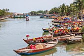 Traditional fishing boats and lantern boats used for tourism trips on Son Thu Bon River, Hoiu An, Quang Nam Provence, Vietnam, Asia