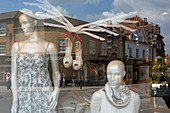 Looking into a shop window with the reflection of houses on Market Place, Henley-upon-Thames, Oxfordshire, England