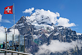 Several people on the terrace at First with a view of Wetterhorn, First, Grindelwald, Bernese Oberland, UNESCO World Natural Heritage Swiss Alps Jungfrau-Aletsch, Bernese Alps, Bern, Switzerland