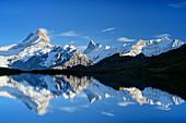 Schreckhorn, Finsteraarhorn and Fiescherhorn are reflected in mountain lake, Bachalpsee, Grindelwald, Bernese Oberland, UNESCO World Natural Heritage Swiss Alps Jungfrau-Aletsch, Bernese Alps, Bern, Switzerland