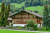 Old farmhouse with carvings, painting and cottage garden, Knuttihaus, Därstetten, Simmental, Bernese Alps, Bern, Switzerland
