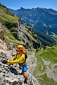 Woman climbs on the Gemmi adventure via ferrata, Gemmi, Bernese Alps, Valais, Switzerland