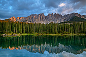 Latemar group is reflected in Karersee, Karersee, Rosengarten, Dolomites, UNESCO World Natural Heritage Dolomites, South Tyrol, Italy