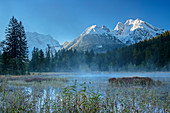 Morning mist at Taubensee with Watzmann and Hochkalter in the background, Taubensee, Berchtesgaden, Berchtesgaden Alps, Upper Bavaria, Bavaria, Germany