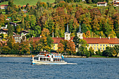 Ship of the Tegernseeschifffahrt in front of St. Quirin Monastery Church and Tegernsee Monastery, Tegernsee, Upper Bavaria, Bavaria, Germany