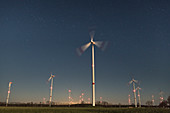 Wind farm in front of starry sky, Germany, Brandenburg,