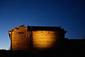 Old wooden hut in late dusk, Tällberg am Siljansee, Dalarna, Sweden