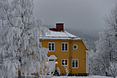 Large, yellow Swedish house in deep winter, Dorotea, Västerbottens Län, Sweden