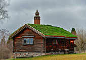 A traditional wooden hut with a grass roof, Tällberg, Dalarna, Sweden
