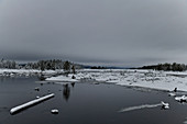 Winter mood at the lake with ice and snow, Lövdden, Lapland, Sweden