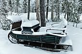 Old sleigh in deep snow, Malå, Lapland, Sweden