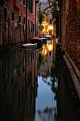 View of a small canal with boats in the evening in San Marco, Venice, Veneto, Italy, Europe