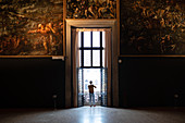 View of a window surrounded by paintings in the Chamber of the Great Council, Palazzo Ducale, San Marco, Venice, Veneto, Italy, Europe
