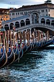 View of the gondolas at the Rialto Bridge on the Grand Canal, Venice, Veneto, Italy, Europe