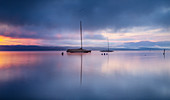 Sailboats on Lake Starnberg in the morning fog at sunrise, Tutzing, Bavaria, Germany