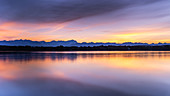 Lake Starnberg at sunset with a view of the mountains, St. Heinrich, Bavaria, Germany