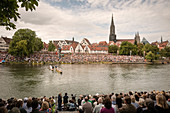 Fish jousting on the Danube in Ulm, view of the old town and Ulm Minster, Swabian Alb, Baden-Württemberg, Germany