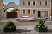 pink red American vintage car parked in front of brewery, Rain am Lech, Donau-Ries district, Bavaria, Danube, Germany