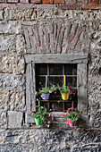 Colorful flower decorations hang on the historic house near the castle in Sigmaringen, Baden-Württemberg, Danube, Germany