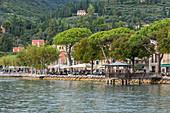The seafront promenade of the town of Garda, Lake Garda, Verona Province, Italy