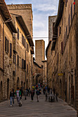 In the alleys of San Gimignano, Province of Siena, Tuscany, Italy