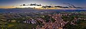 Bird's eye view of sunrise over San Gimignano, Province of Siena, Tuscany, Italy