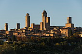 First light on the towers of San Gimignano, Province of Siena, Tuscany, Italy