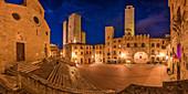 Evening mood at Piazza della Duomo, San Gimignano, Province of Siena, Tuscany, Italy