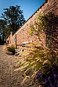Bench in the kitchen garden, Eutin Castle Garden, Holstein Switzerland Nature Park, Ostholstein, Schleswig-Holstein, Germany