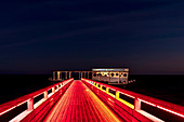 Light illumination of the pier in Kellenhusen at the blue hour, Baltic Sea, Ostholstein, Schleswig-Holstein, Germany