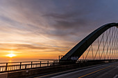 View from the Fehmarnsund Bridge into the sunrise, Fehmarn, Grossenbrode, Ostholstein, Schleswig-Holstein, Germany