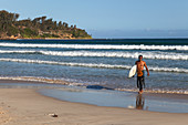 Surfers on the beach at Fort Dauphin, Tolagnaro, Southern Madagascar, Africa
