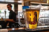 Mug of Hinano beer on counter of a bar, Papeete, Tahiti, Windward Islands, French Polynesia, South Pacific