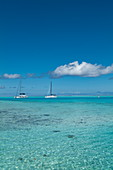 Catamaran sailboats in the turquoise waters of the Bora Bora Lagoon, Bora Bora, Leeward Islands, French Polynesia, South Pacific