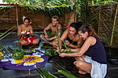 Traditional weaving with pandanus leaves during an immersion workshop in the ELK cultural village, Apootaata, Moorea, Windward Islands, French Polynesia, South Pacific