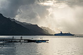 Cruise ship MS Astor (Transocean Cruises) leaves Opunohu Bay during a thunderstorm, Moorea, Windward Islands, French Polynesia, South Pacific