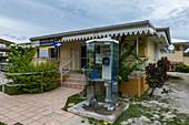 Telephone box in front of the Fakarava Post Office, Fakarava Atoll, Tuamotu Islands, French Polynesia, South Pacific