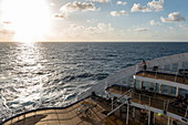 Rear sundeck of the Aranui 5 (Aranui Cruises) passenger cargo ship at sunset, at sea between the Tuamotu Islands and the Marquesas Islands, French Polynesia, South Pacific