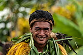 "A Marquesan ""warrior"" smiles at the camera at a cultural event for passengers on the Aranui 5 (Aranui Cruises) passenger cargo ship, Hatiheu, Nuku Hiva, Marquesas Islands, French Polynesia, South Pacific"
